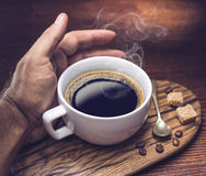 Cup of coffee and cane sugar cubes. Stock Images