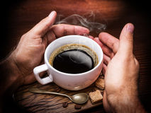 Cup of coffee and cane sugar cubes. Stock Image