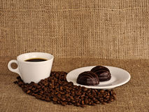 Cup of coffee on a canvas background. Royalty Free Stock Image