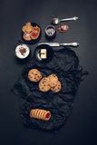 Cup of coffee, cappuccino with chocolate cookies and biscuits on black table background. Afternoon break time. Breakfast. Royalty Free Stock Image