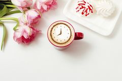 Cappuccino with a clock. A cup of coffee cappuccino with a clock pattern from cinnamon on milk foam royalty free stock image