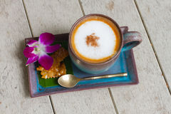 A cup of coffee cappucino. Wooden background royalty free stock image