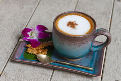 A cup of coffee cappucino. Wooden background royalty free stock photo