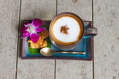 A cup of coffee cappucino. Wooden background stock photos