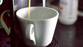 Cup of coffee from capsule coffee machine stock video footage
