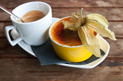 Cup of  coffee and caramelised  cream Royalty Free Stock Photo