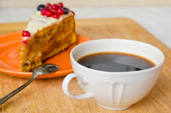 Cup of coffee with carrot cake. A composition with a cup of freshly brewed coffee and home made carrot cake Royalty Free Stock Photo