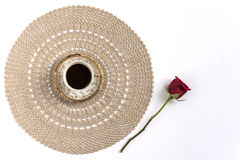 Cup of coffee at the center of a lace with a red rose Royalty Free Stock Photo