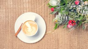 Cup of coffee or chai tea with latte art and Christmas decor. Le Stock Photography