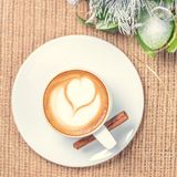 Cup of coffee or chai tea with latte art and Christmas decor. Le Stock Photo
