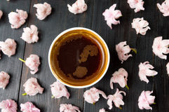 Cup of coffee and cherry blossom flowers Stock Photo