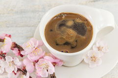 Cup of coffee with cherry blossom flowers Royalty Free Stock Photo