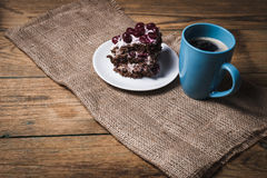 Cup of coffee and cherry cake Royalty Free Stock Photos