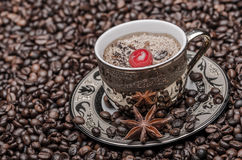 Cup of coffee with cherry  and coffee beans Royalty Free Stock Photos
