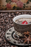 Cup of coffee with cherry  and coffee beans Royalty Free Stock Photo