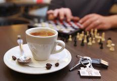 Cup of coffee and chess. On the desk Stock Images