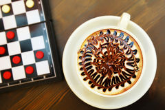 Cup of coffee and chess. On the desk Stock Image