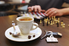 Cup of coffee and chess. On the desk Royalty Free Stock Photography