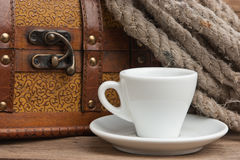 Cup of coffee and chest Royalty Free Stock Photos