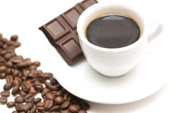 Cup of coffee with chocolate. And roasted coffee beans Royalty Free Stock Photo