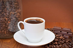 Cup of coffee and chocolate. On the wooden table stock image