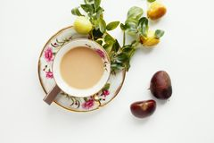 A cup of coffee with chocolate. Beautiful vintage cup full of coffee with little apples, chocolate and chestnuts Stock Photography