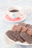 Cup of coffee and chocolate biscuits Royalty Free Stock Images
