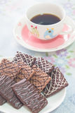 Cup of coffee and chocolate biscuits. Chocolate biscuits with a coffee in the lovely cup Royalty Free Stock Image