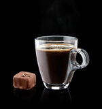 Cup of coffee with a chocolate bonbon Stock Photo