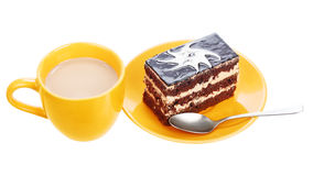 Cup of coffee and chocolate cake on orange plate Stock Image