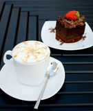 Cup of coffee with a chocolate cake royalty free stock photography