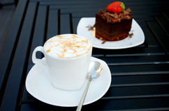 Cup of coffee with a chocolate cake stock image