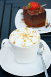 Cup of coffee with a chocolate cake royalty free stock image