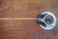 A coffee cup on an old wooden table royalty free stock photos