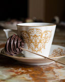 Cup of coffee and chocolate candie Royalty Free Stock Images