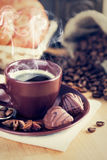 Cup coffee with chocolate candies Stock Photos