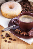 Cup coffee with chocolate candies Stock Photography