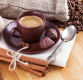 Cup coffee with chocolate candies Royalty Free Stock Photos