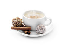 Cup of coffee with chocolate candies and cinnamon Stock Photos