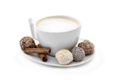 Cup of coffee with chocolate candies and cinnamon Royalty Free Stock Images