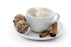 Cup of coffee with chocolate candies and cinnamon Royalty Free Stock Image