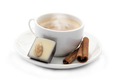 Cup of coffee with chocolate candy and cinnamons Stock Photo