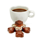 Cup of coffee and chocolate candy Stock Photos