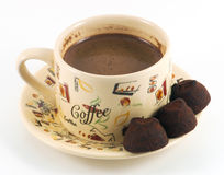 Cup of coffee with chocolate candy. On a white background Stock Image
