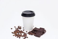 Cup of coffee and chocolate chips, coffee beans Royalty Free Stock Photography