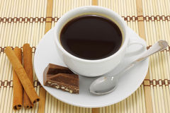 Cup of coffee with chocolate and cinnamon Stock Photo