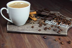 Cup of coffee, chocolate, cinnamon, anisetree and inscription time for coffee. On a wooden background Stock Images