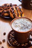 Cup of coffee and chocolate cookie on table. Cup of coffee and chocolate cookies on table Stock Photography