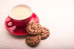 Cup with coffee and chocolate cookie Stock Image
