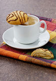 Cup of coffee with chocolate cookies. On a linen napkin Royalty Free Stock Photo